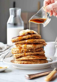 The BEST banana pancakes! These guys are warmly spiced fluffy & healthy made with oat flour whole wheat flour and no added sweetener. Totally vegan they're a fun wholesome breakfast! Best Brunch Recipes, Vegan Breakfast Recipes, Vegan Recipes, Breakfast Ideas, Easy Recipes, Vegan Banana Pancakes, Healthy Banana Bread, Breakfast Pancakes, Banana Oats