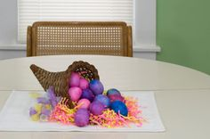 This is a cute way to reuse your cornucopia from Thanksgiving or Autumn decorations. You can use leftover dyed eggs along with some raffia as well as whatever other cute accents you want to add such as small flowers, Easter candy, Peeps or chenille miniature chicks to create an Easter cornucopia fit to accompany a bounty of Easter deliciousness.
