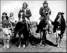 Geronimo with his warriors on horseback.