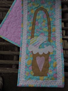 This Extra Long Skinny Runner features Appliqued Easter Baskets with Lace along the Edges. Inside are Three Coordinating Easter Eggs in all Pastels. This was machine appliqued then machine quilted on my longarm.  The Back Side is Pink and the Binding is the same Fabric used on the Background. It measures 43.5 long by 9 wide and was made in my smoke free home. Warm and Natural Batting was used inside.   Ready to ship.