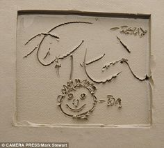 Art attack: The picture of Tom and Jerry created by the Duke of Cambridge.  Pince William draws a picture in the clay tile which will be hung right beside Kate's.  ...........September 13, 2012