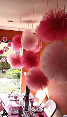 Tulle pom poms....these would look great for Min's room! might use tissue