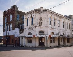 This Cajun Corner Cafe Louisiana Photograph is a rare piece of history in a small Louisiana town. This classic old building has been through so much in the last 70 years and is a great example of why