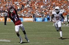 Oklahoma's Dede Westbrook (11) makes a long catch for a touchdown next to Texas' Holton Hill (5) during the Red River Showdown college football game between the University of Oklahoma Sooners (OU) and the Texas Longhorns (UT) at Cotton Bowl Stadium in Dallas, Saturday, Oct. 8, 2016. Oklahoma won 45-40. Photo by Bryan Terry, The Oklahoman