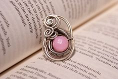 Hey, I found this really awesome Etsy listing at http://www.etsy.com/listing/165239972/pink-quartz-ring-wire-wrapped-jewelry