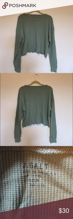 Brandy Melville Laila green thermal Long Sleeve waffle printed thermal in green. It has a ribbed collar and cuffs with raw edge trimmings at the waist. Has a V-shaped detailing at the neck with thick stitching. Should fit Xs-Medium! Brand new, never washed or worn! **NO TRADES** Brandy Melville Sweaters Crew & Scoop Necks