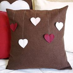 Instructions for a simple Valentine's Day pillow made with felt hearts.