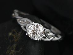 This engagement ring is a Celtic knot inspired design. It is simple yet unique. This is a great clear alternative to a diamond! So much more
