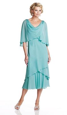Chiffon below-the-knee A-line mother of the bride dress features draped sleeves with slits, front and back cowl necklines with beaded accents at shoulders, cape-like draped empire bodice trimmed with hand-beading, crisscross layered hemline.