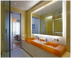 Windowless bathroom, retrofitted light and milk glass sliding door. Brooklyn Modern by 1100 Architect