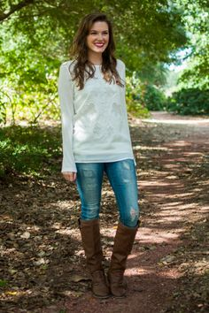 """We L-O-V-E this white blouse! The open design on the front is absolutely breathtaking and we absolutely love how easy it is to style!   Material has no amount of stretch in the front, generous amount in the back. You might want a cami handy with this one! :)  Haylee is wearing the size small.   Sizes fit:  Small- 0-4; Medium- 6; Large- 8   Length from shoulder to hem: S- 26""""; M- 27""""; L- 28""""."""