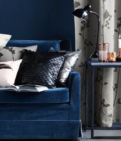 AphroChic: Glam Pieces at H&M Home.  Blue sofa.