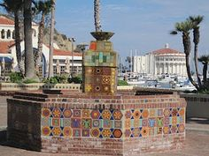 Hand made tile created in the 1930's for Wriggley: Santa Catalina Island, off Long Beach: tile facade fountain in Avalon, with Catalina Casino in the background.