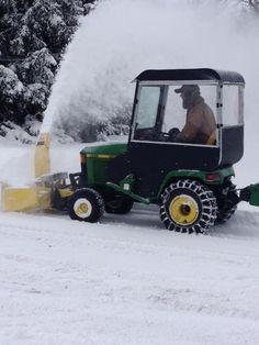 John Deere 445 blowing snow