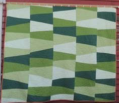 This quilt, hand-quilted, was inspired by a Gee's Bend denim quilt and by my frequent drives across the hillsides of North Alabama -- Hamilton County, in particular.  This quilt is lined in orange flannel. I love it.