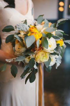 loving this yellow bouquet, photo by Kate Ignatowski http://ruffledblog.com/new-orleans-inspired-wedding-ideas #flowers #weddingbouquet