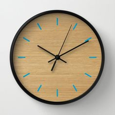 """wood pattern Clock, Modern Wall Clock, Modern Clock, The Modern Clock, wood and blue clock, wood pattern clock, modern wall clock by STANLEYprintHOUSE  47.00 USD  Available in natural wood, black or white frames, our 10"""" diameter unique Wall Clocks feature a high-impact plexiglass crystal face and a backside hook for easy hanging. Choose black or white hands to match your wall clock frame and art design choice. Clock sits 1.75"""" deep and requi ..  https://www.etsy.com/ca/listing/259.."""