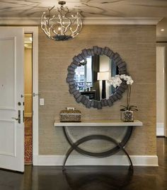 entryway decorating with console table and wall mirror