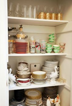 organized china and dishware closet