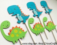 Dinosaur Birthday Centerpiece Decorations. Dinosaurs will measure approx. 5 tall and will be on 6 or 12 inch sticks-use the dropdown to choose! You will receive 1 of each design - total of 2. 3-piece centerpieces are available as well if youd like a 3rd stick to say roar or a number for the childs name! Matching cupcake toppers: https://www.etsy.com/listing/225457368/dinosaur-cupcake-toppers-dinosaur-party Matching banner: https://www.etsy.com/listing/221834774/dinosaur-banner-dinosaur-cu...
