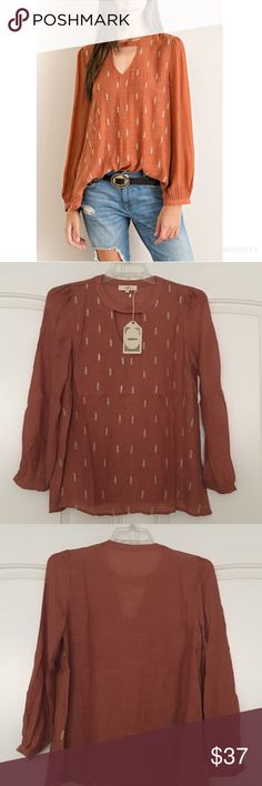 entro Solid Blouse Solid Blouse with Embroidery Detail by entro. Crinkled Blouse with cutout on bust with button closure. The Blouse is lined in the front. 65% rayon, 35% polyester. Color is Rust. ( The cover shot is true to color) 🚫Price is firm entro Tops Blouses