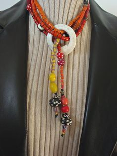 Warm and Bold Antique African Trade and Naga Tile Bead Lariat. Morning Dove Design, via Etsy.