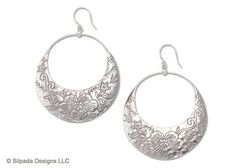 Sterling Silver Earrings with floral etchings.