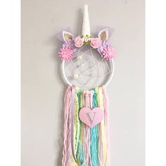 Unicorm Dreamcatcher with added webbing and beads as well as an initial on the heart. Made using a 6inch hoop and tassels around 25-30cm long. Pop a note on your order with your required initial and any colour preferences you have :)