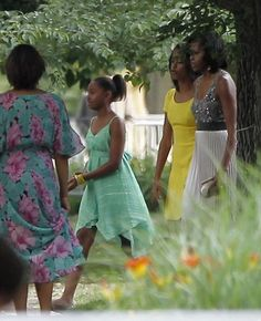 First Lady Michelle Obama walks with her daughters Sasha and Malia to the home of Valerie Jarrett, President Obama's advisor, in Chicago June 16, 2012. The Obamas attended the wedding of Valerie's daughter Laura on Saturday.