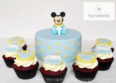 baby mickey mouse cake and cupcakes