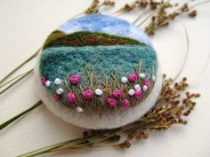 Unique handmade brooch made of wool. Needle felted brooch with floral pattern. Brooch is fitted with a metal brooch pin. 6cm in diameter  Please note that In reality colors of brooch may look slightly different than colors in photos on your screen. It depends on your monitor and its color rendering.