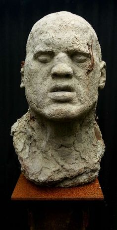 #Cast #concrete, with rusted #metal inserts #sculpture by #sculptor Marc Bodie titled: 'Lost Boy (Big Male Bust Head Garden sculpture)'. #MarcBodie