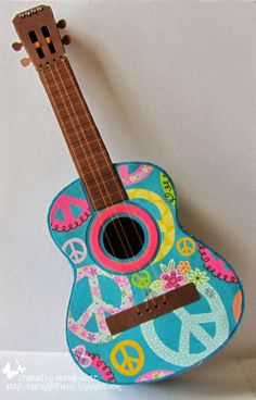 Ok, Mary makes amazing projects every week, but check this out, a 3D Guitar. Oh and it's a box, yep! This is Norma Jean's Box and omg, how cute is this! I know what your doing, all the ideas are just going through your head right now, aren't they, I'm right, I know, 'cause that's what I do each time I look at it! Ahhh, so many ideas, so little time! You can find this so, so, amazing file in VINTAGE VALENTINES SVG KIT! And yes, it has strings on it, it does look so real!