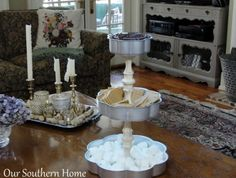 Wow your kids or guests by making a s'mores station out of dollar-store cake pans and candlesticks.   21 Ingenious Dollar Store Ideas You'll Want To Try