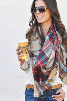 "Oversized, cozy, and so perfectly plaid blanket scarf.  The Pippa scarf is as good as it gets for this winter and spring staple.  Measuring a whopping 55″ x 55″ it is sure to keep you cozy warm as a scarf, shawl, or just about any other way you would like to wear this beauty.  A great pop of color when paired with our 'Walkin Asymmetrical Top,' and our ""Piece of Me Jean', as shown here."