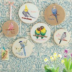 cross-stitch birds in hoops