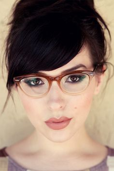 Cat eye brown ombre plastic eyeglass frames.  Also, bangs and neutral lipstick. Win.