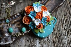 Colors in a teacup - polymer clay teacup with blue, orange and white flowers by Zubiju