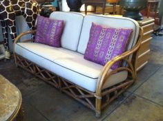 This 1950s rattan sofa comes with a matching club chair and would be great for use either indoors or outdoors. The chair has an elegant design and is both comfortable and durable.