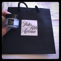 NWT Saks Fifth Ave shear butter balm & mini bag ! NWT SAKS FIFTH AVENUE lip moisturizer Shea butter balm clear ! Comes with the black mini bag ! Purchases from the amazing NYC location! Box that has the balm got jostled around in the bigger bag from shoe boxes! Also tore it a little taking balm out for pictures, but balm is in 100% perfect condition, as is bag (swapped it for a perfect one)! Makes a lovely gift for someone else or yourself  great quality balm and sheer application! Saks…