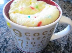 8 Tablespoons Funfetti Boxed Cake Mix 1 whole Egg Beaten 1 Tablespoon Vegetable Oil 3 Tablespoons Water  Spray a mug liberally with cooking spray. Add egg, oil, and water to cake mix, and mix with a fork until creamy. Microwave on HIGH for 1 minute 30 seconds. Microwave 30 seconds more if still gooey.  http://tastykitchen.com/recipes/desserts/funfetti-mug-cake/