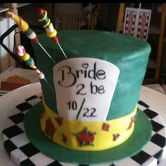 like the idea of putting the date of wedding on the cake if doing a hat