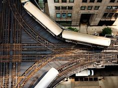 """Elevated Train Picture — Chicago Wallpaper — National Geographic Photo of the Day It's a snug fit for Chicago's famous """"L"""" tracks, here shot from above by National Geographic Your Shot community member Angie McMonigal. Flanked on two sides by the elevated rail, the art deco Trustees System Service Building, now a condominium, dates to 1930. http://yellowblog.tumblr.com"""