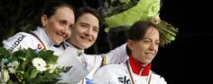 GB's Helen Wyman (right) celebrates her 2014 world championship bronze medal with Marianne Vos and Eva Lechner