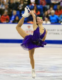 Akiko Suzuki of Japan skates during the ladies short program 2013 Skate Canada Purple Figure Skating / Ice Skating dress inspiration for Sk8 Gr8 Designs.