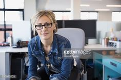 Stock Photo : Portrait of confident businesswoman in office