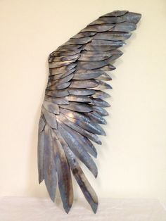 "Metal Wing Sculpture ""Wing And A Prayer""  Steel sheetmetal was hand cut, cold formed and welded to form this graceful single wing sculpture. This piece can be hung on a wall at any angle. I decided to leave it in its original metal state and have only added a protective clear coat."