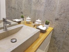 coral gray limestone tiles on the wall with silver sink on wooden venity top