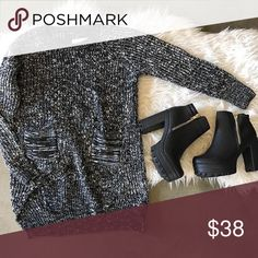 Black and White Sweater Black and white sweater, never worn! *not free people, got it from a local boutique!* Free People Sweaters