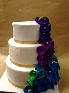 Peacock themed wedding cake.